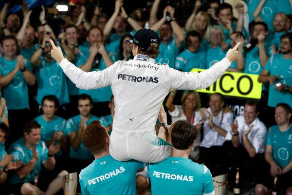 Yas Marina Circuit, Abu Dhabi, United Arab Emirates. Sunday 27 November 2016. Nico Rosberg, Mercedes AMG, 2nd Position, celebrates becoming World Champion with his team. World Copyright: Glenn Dunbar/LAT Photographic ref: Digital Image _X4I5899