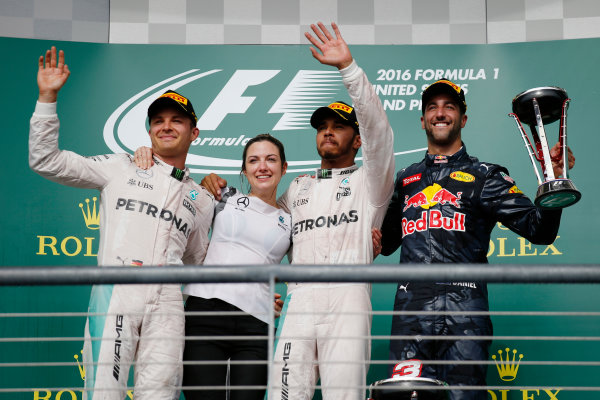 Circuit of the Americas, Austin Texas, USA. Sunday 23 October 2016. Winner Lewis Hamilton, Mercedes AMG, celebrates on the podium with Nico Rosberg, Mercedes AMG, Victoria Vowles, Mercedes AMG, and Daniel Ricciardo, Red Bull Racing. World Copyright: Sam Bloxham/LAT Photographic ref: Digital Image _SLA2657