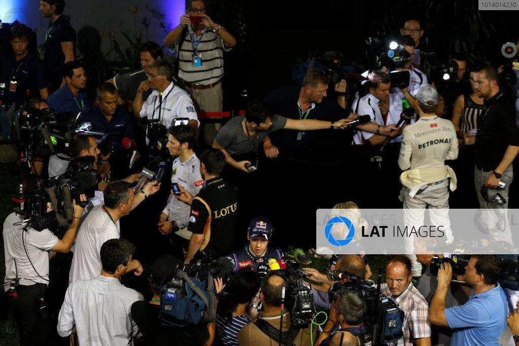 Marina Bay Circuit, Singapore. Saturday 21st September 2013.  Nico Rosberg, Mercedes AMG, Sebastian Vettel, Red Bull Racing, and Romain Grosjean, Lotus F1, talk to the media after qualifying.  World Copyright: Charles Coates/LAT Photographic. ref: Digital Image _N7T5502