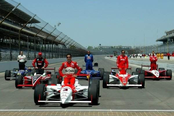 The six former Indy 500 winners, L to R  Buddy Lazier (USA), Al Unser Jr. (USA), Helio Castroneves (BRA), Eddie Cheever (USA),  Arie Luyendyke (NED) and Kenny Brack (SWE), pose for pictures before the opening of practice for the Indianapolis 500.Indy 500 Practice, Indianapolis Motor Speedway, Indianapolis, USA, 5 May 2002. DIGITAL IMAGE