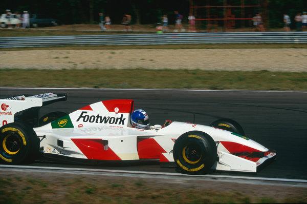 1993 Hungarian Grand Prix.Hungaroring, Budapest, Hungary. 13-15 August 1993.Derek Warwick (Footwork FA14 Mugen-Honda) 4th position.Ref-93 HUN 17.World Copyright - LAT Photographic