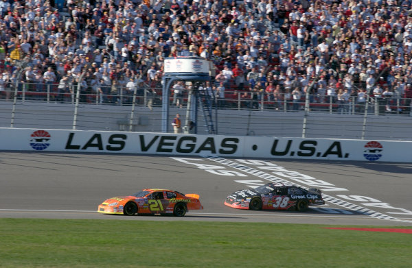 05-06 March 2004,Las Vegas Motor Speedway, USA, Sams Town 300Kasey Kahne chases Kevin Harvick over the finish line,Copyright-Robt LeSieur 2004LAT Photographic