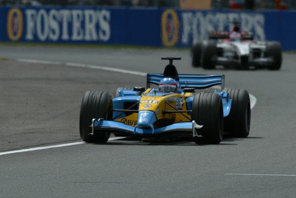 2003 British Grand Prix - Sunday race, Silverstone, England.20th July.Fernando Alonso, Renault R23, leads Jenson Button, B-A-R Honda 005, action.World Copyright LAT Photographic.Digital Image Only.