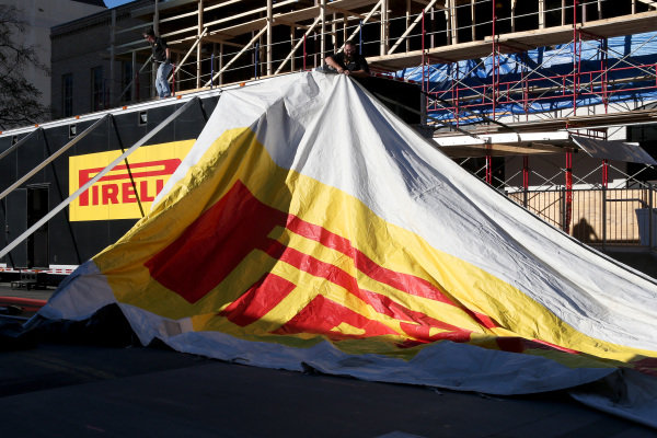 Pirelli branded awning being constructed. FOTA Austin Fans Forum, Cedar Street Courtyard, Austin, Texas, Wednesday 13 November 2013.