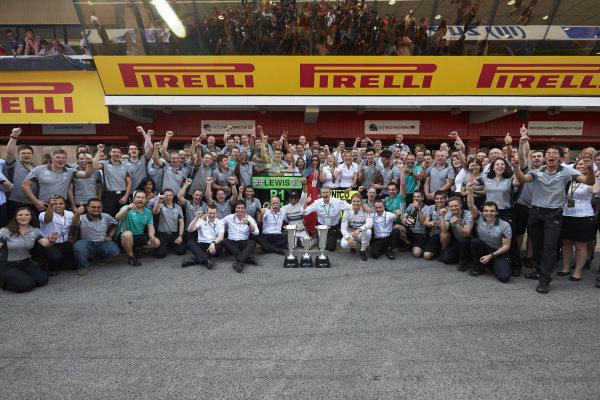 Circuit de Catalunya, Barcelona, Spain. Sunday 11 May 2014. Lewis Hamilton, Mercedes AMG, 1st Position, Nico Rosberg, Mercedes AMG, 2nd Position, and the Mercedes AMG team celebrate a perfect weekend. World Copyright: Steve EtheringtonLAT Photographic. ref: Digital Image SNE25423 copy