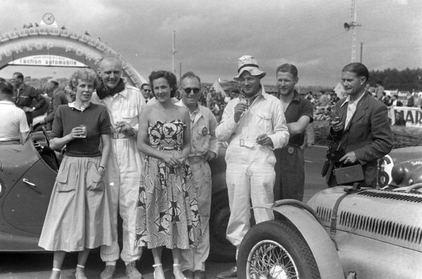 Drivers, wives and team members celebrate at the end of the race.