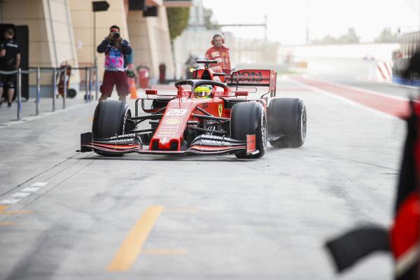 Mick Schumacher, Ferrari SF90, returns to the garage