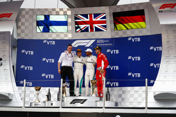 James Allison, Technical Director, Mercedes AMG, Valtteri Bottas, Mercedes AMG F1, 2nd position, Lewis Hamilton, Mercedes AMG F1, 1st position, and Sebastian Vettel, Ferrari, 3rd position, on the podium