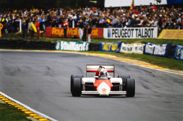 Alain Prost, McLaren MP4-2B TAG, raises his arm and waves as he celebrates his first world championship.
