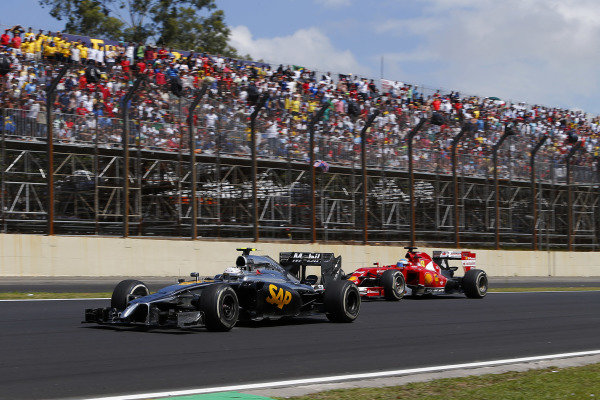 (L to R): Kevin Magnussen (DEN) McLaren MP4-29 and Fernando Alonso (ESP) Ferrari F14 T. Formula One World Championship, Rd18, Brazilian Grand Prix, Race, Sao Paulo, Brazil, Sunday 9 November 2014.