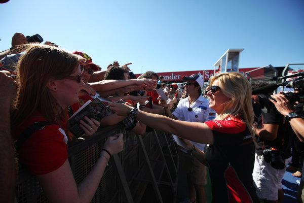 Valencia Street Circuit, Valencia, Spain 21st June 2012. Maria de Villota, Marussia F1, signs autographs for fans.  World Copyright:Glenn Dunbar/LAT Photographic ref: Digital Image IMG_3302