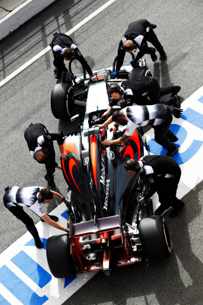 Circuit de Catalunya, Barcelona, Spain Monday 22 February 2016. Jenson Button, McLaren MP4-31 Honda, gets pushed back into the garage. World Copyright: Steven Tee/LAT Photographic ref: Digital Image _H7I0426
