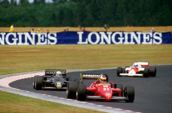 Nurburgring, Germany.2-4 August 1985.Michele Alboreto (Ferrari 156/85) 1st position leads Elio de Angelis (Lotus 97T Renault) and Alain Prost (McLaren MP4/2B TAG Porsche).Ref-85 GER 10.World Copyright - LAT Photographic
