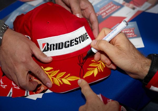Suzuka Circuit, Suzuka, Japan. 1st October 2009. Jarno Trulli, Toyota TF109, autographs a Bridgestone hat. Atmosphere.  World Copyright: Steve Etherington/LAT Photographic ref: Digital Image SNE29831