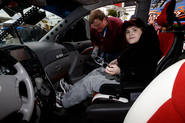15-16 October, 2009, Concord, North Carolina, USAKody Harlow, winner of the Toyota Mobility/Braun Ultimate fan van giveaway tries out his new van.©2009, Michael L. Levitt, USALAT Photographic