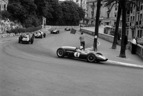 1960 Monaco Grand Prix.Monte Carlo, Monaco. 29 May 1960.Jack Brabham, Cooper T53-Climax, disqualified, leads Jo Bonnier, BRM P48, 5th position, Tony Brooks, Cooper T51-Climax, 4th position, Phil Hill, Ferrari Dino 246, 3rd position, and Graham Hill, BRM P48, 7th position, action.World Copyright: LAT PhotographicRef: Autosport b&w print. Published: Autosport, 10/6/1960 p798