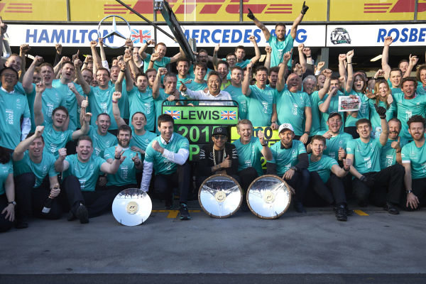 Albert Park, Melbourne, Australia. Sunday 15 March 2015. Lewis Hamilton, Mercedes AMG and Nico Rosberg, Mercedes AMG celebrate with their team after winning the race. World Copyright: Steve Etherington/LAT Photographic. ref: Digital Image SNE21605