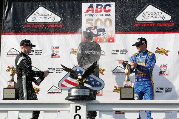 Verizon IndyCar Series ABC Supply 500 Pocono Raceway, Long Pond, PA USA Sunday 20 August 2017 Will Power, Team Penske Chevrolet, Josef Newgarden, Team Penske Chevrolet, Alexander Rossi, Curb Andretti Herta Autosport with Curb-Agajanian Honda celebrate with champagne on the podium World Copyright: Phillip Abbott LAT Images ref: Digital Image abbott_pocono_0817_8080
