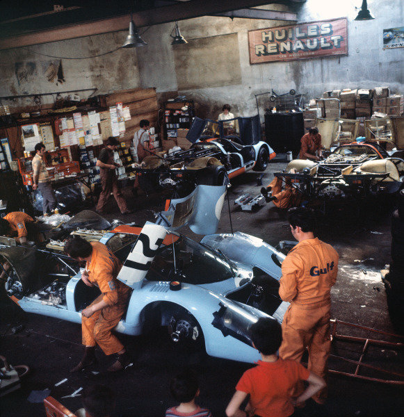 Le Mans, France. 13th - 14th June 1970. Gulf Porsche team mechanics at work in their garage, portrait.  World Copyright: LAT Photographic. Ref:  Colour Transparency