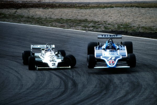 Carlos Reutemann (ARG), Williams FW07C, attempts to overtake Jacques Laffite (FRA), Ligier JS17, on lap 18. Reutemann then crashed into the side of Laffite briefly launching him into the air and then into the catch-fencing. Reutemann retired with broken suspension.Dutch Grand Prix, Rd12, Zandvoort, The Netherlands, 30 August 1981.BEST IMAGE