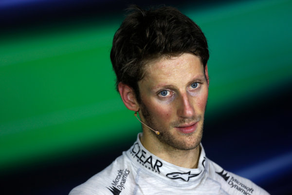 Marina Bay Circuit, Singapore. Saturday 21st September 2013.  Romain Grosjean, Lotus F1, in the press conference after qualifying.  World Copyright: Charles Coates/LAT Photographic. ref: Digital Image _N7T5297