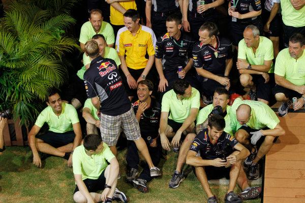 Marina Bay Circuit, Singapore. Sunday 22nd September 2013.  Sebastian Vettel during the Red Bull Racing celebration team photo.  World Copyright: Jed Leicester/LAT Photographic. ref: Digital Image _JEL3273