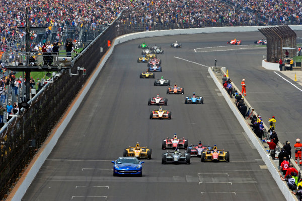 26 May, 2013, Indianapolis, Indiana, USA Under yellow, winner Tony Kanaan (#11) leads Carlos Munoz (#26), Ryan Hunter-Reay (#1) and the field across the finish line taking the checkered flag ©2013, F. Peirce Williams LAT Photo USA