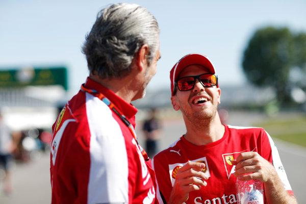 Circuit Gilles Villeneuve, Montreal, Canada. Thursday 4 June 2015. Mauricio Arrivabene, Team Principal, Ferrari, and Sebastian Vettel, Ferrari, share a joke. World Copyright: Alastair Staley/LAT Photographic. ref: Digital Image _79P8491