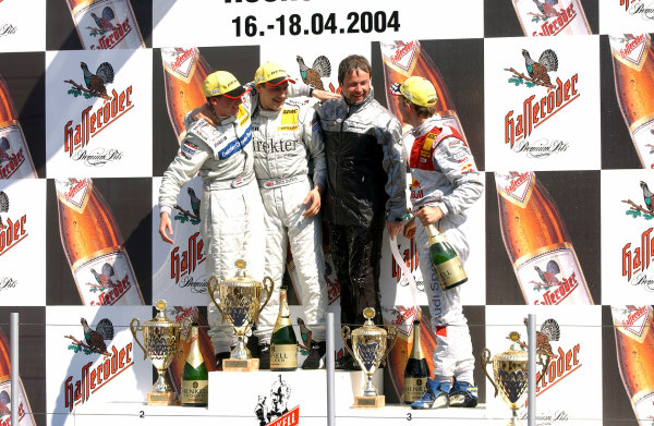 2004 German Tourng Car (DTM) Championship Hockenheim, Germany, 18th April 2004Gary Paffet (HWA Mercedes C-Class) celebrates his first DTM win on the podium with second placed Christijan Albers (HWA Mercedes C-Class) and third placed Mattias Ekstrom (Abt Sportsline Audi A4).World Copyright: Irlmeier/LAT Photographic ref: Digital Image Only
