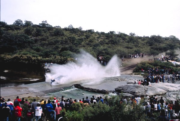 2003 World Rally ChampionshipRally Argentina, Cordoba, Argentina, 7th - 11th May 2003.A Subaru looses its bumper going through a water splash.World Copyright: LAT Photographicref: 03WRCArg02