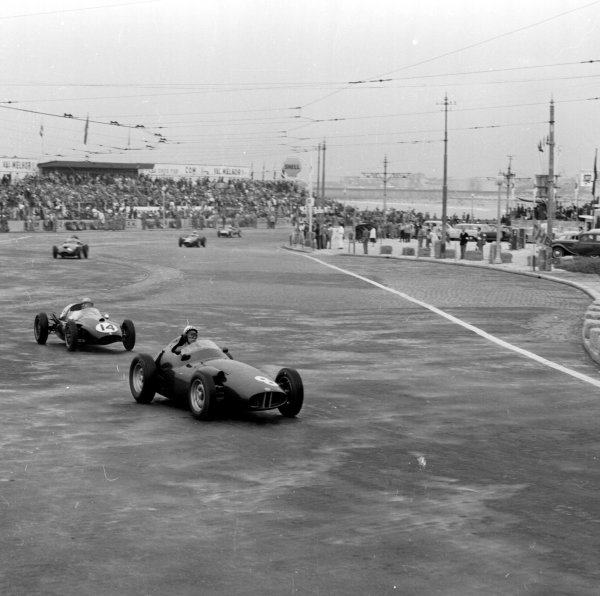 1958 Portuguese Grand Prix.Porto, Portugal.22-24 August 1958.Jean Behra (BRM P25) leads Jack Brabham (Cooper T45-Climax). Behra finished in 4th position.Ref-2417.World Copyright - LAT Photographic
