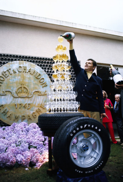 Moet & Chandon prepares a promotional glass pyramid of champagne on a Goodyear tyre.