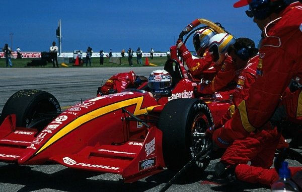 Alex Zanardi (ITA) Target Chip Ganassi Racing, takes a pitstop on the way to victory.CART Fedex World Series, Rd10, Cleveland, Ohio, USA. 12 July 1998.