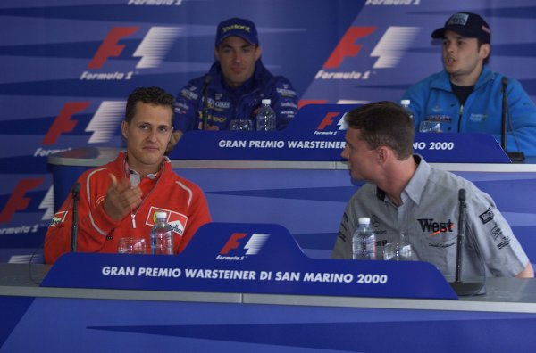 2000 San Marino Grand Prix.Imola, Italy. 7-9 April 2000.David Coulthard (McLaren Mercedes) has a chat with Michael Schumacher (Ferrari) in a press conference.World Copyright - LAT Photographic