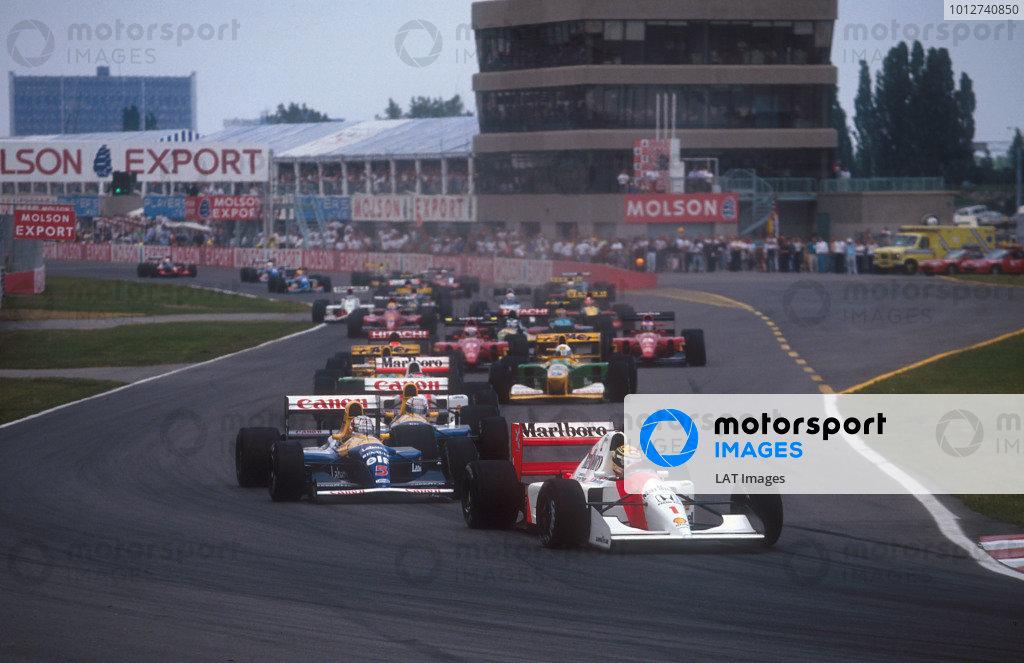1992 Canadian Grand Prix.Montreal, Quebec, Canada.12-14 June 1992.Ayrton Senna (McLaren MP4/7A Honda) leads Nigel Mansell, Riccardo Patrese (both Williams FW14B Renault), Gerhard Berger (McLaren MP4/7A Honda), Michael Schumacher and Martin Brundle (both Benetton B192 Ford's) at the start. Ref-92 CAN 01.World Copyright - LAT Photographic