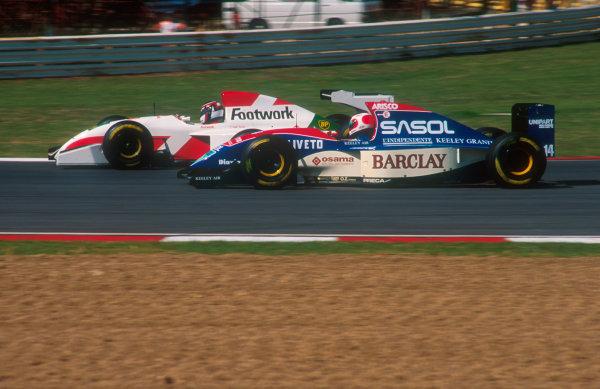 1993 South African Grand Prix.Kyalami, South Africa.12-14 March 1993.Rubens Barrichello (Jordan 193 Hart) battles with Aguri Suzuki (Footwork FA13B Mugen-Honda).Ref-93 SA 13.World Copyright - LAT Photographic