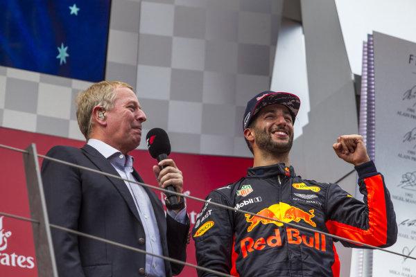 Martin Brundle (GBR) Sky TV and Daniel Ricciardo (AUS) Red Bull Racing celebrate on the podium at Formula One World Championship, Rd9, Austrian Grand Prix, Race, Spielberg, Austria, Sunday 9 July 2017.