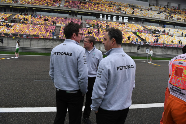 Simon Cole (GBR) Mercedes AMG F1 Chief Track Engineer, Ron Meadows (GBR) Mercedes AMG F1 Team Manager and Andy Shovlin (GBR) Mercedes AMG F1 Engineer on the grid at Formula One World Championship, Rd2, Chinese Grand Prix, Race, Shanghai, China, Sunday 9 April 2017.