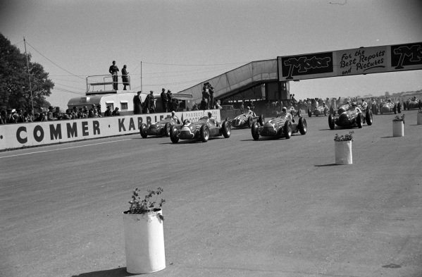 "Luigi Fagioli, Alfa Romeo 158, leads Giuseppe Farina, Alfa Romeo 158, Juan Manuel Fangio, Alfa Romeo 158, ""B. Bira"", Maserati 4CLT/48, and the rest of the field at the start of the race."