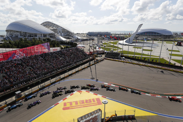 Charles Leclerc, Ferrari SF90, leads Lewis Hamilton, Mercedes AMG F1 W10, Carlos Sainz Jr., McLaren MCL34, Valtteri Bottas, Mercedes AMG W10, Lando Norris, McLaren MCL34, Sergio Perez, Racing Point RP19, Max Verstappen, Red Bull Racing RB15, Nico Hulkenberg, Renault R.S. 19 and the rest of the pack at the start