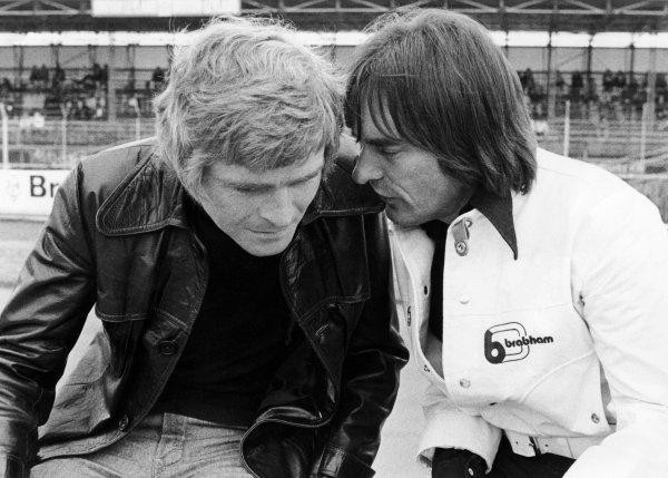 1973 British Grand Prix.  Silverstone, England. 12-14th July 1973.  Max Mosley, March Team Principal talks with Bernie Ecclestone, Brabham Team Owner in the pits, portrait. World Copyright: LAT Photographic.  Ref:  B/W Print.