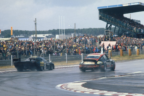 1980 Le Mans 24 Hours. Le Mans, France. 14th - 15th June 1980. Jean Rondeau / Jean-Pierre Jaussaud (Rondeau M379B Ford), 1st position, passes Thierry Perrier / Roger Carmillet  (Porsche 911 SC), 16th overall and 1st in GT Class, action.  World Copyright: LAT Photographic. Ref: 80LM04.