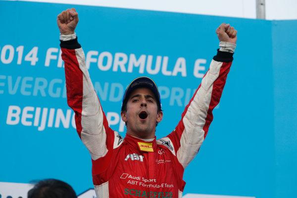 FIA Formula E -  Podium Beijing E-Prix, China Saturday 13 September 2014. Lucas di Grassi (Abt) celebrates on the podium after winning the race. Photo: Glenn Dunbar/LAT/ Formula E ref: Digital Image _W2Q2253