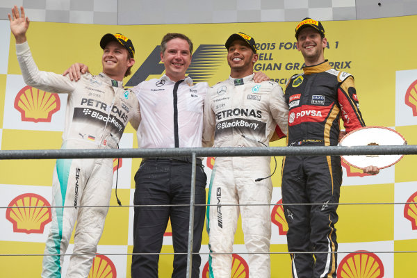 Spa-Francorchamps, Spa, Belgium. Sunday 23 August 2015. Nico Rosberg, Mercedes AMG, Lewis Hamilton, Mercedes AMG and Romain Grosjean, Lotus F1 celebrate on the podium after the race. World Copyright: Steve Etherington/LAT Photographic ref: Digital Image SNE22664