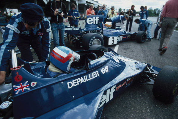 Patrick Depailler and team mate Jody Scheckter both sat in their Tyrrell 007 Fords waiting to go on track.