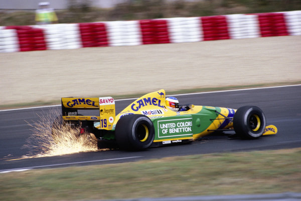 Michael Schumacher, Benetton B192 Ford, with sparks flying.