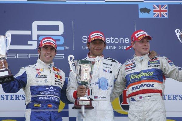 2006 GP2 Series.Round 6.  Silverstone, England.  11th June 2006.  Sunday race.  Lewis Hamilton (GBR, ART Grand Prix) 1st, Felix Porteiro (ESP, Campos Racing) 2nd and Adam Carroll (GBR, Racing Engineering) 3rd. Podium. World Copyright: Andrew Ferraro/GP2 Series Media Service. Ref: Digital Image Only.YY8P4334.jpg