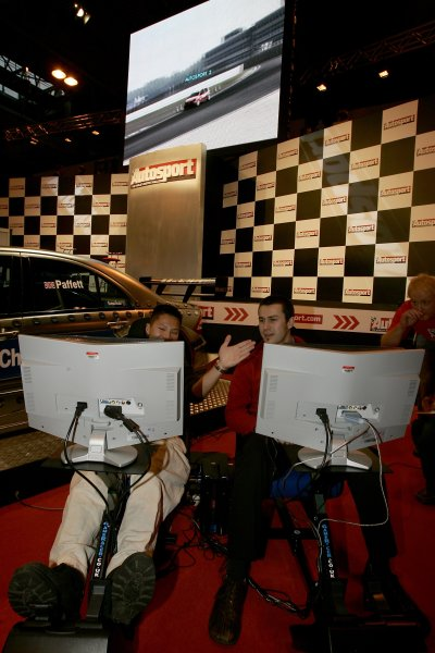 2006 Autosport InternationalBirmingham NEC, Thursday 12th January 2006.Visitors try their hand at the codemasters challenge on the main stage.World Copyright: Andrew Ferraro/LAT Photographicref: Digital Image Only