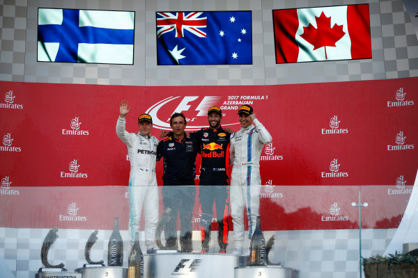Baku City Circuit, Baku, Azerbaijan. Sunday 25 June 2017. Valtteri Bottas, Mercedes AMG, 2nd Position, Pierre Wache, Chief Engineer Performance Engineering, Red Bull Racing, Daniel Ricciardo, Red Bull Racing, 1st Position, and Lance Stroll, Williams Martini Racing, 3rd Position, on the podium. World Copyright: Andrew Hone/LAT Images ref: Digital Image _ONZ8559