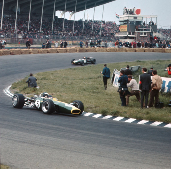 Zandvoort, Holland.2-4 June 1967.Jim Clark (Lotus 49 Ford) leads Jack Brabham (Brabham BT19 Repco). They finished in 1st and 2nd positions respectively.Ref-3/2887A.World Copyright - LAT Photographic